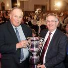 Cup winner Thomas Gilpin receives the Belfast Telegraph Cup from UFU president Ivor Ferguson