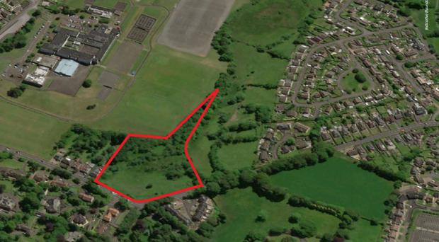 The 3.26-acre site (highlighted) has a guide price of £495,000