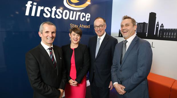 Mark Slaughter (second from right), director general for investment, Department for International Trade, with (L-R) Sean Canning, Laura Hourican and Kieran Long from Firstsource Solutions