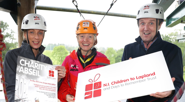 Jim Burke and Lorraine Weir from Hagan Homes take part in training with Nicola Campbell (centre) at Belfast Activity Centre ahead of their charity abseil