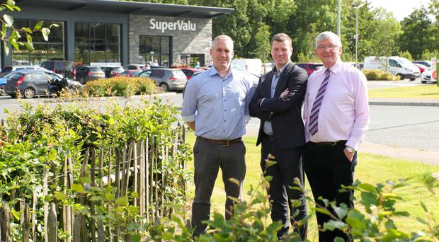 Philip and Neville Woods with SuperValu sales director Nigel Maxwell (centre) outside the rebranded Richhill