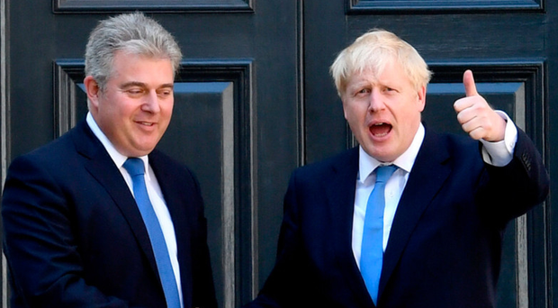Tory chairman Brandon Lewis (left) congratulates new party leader and Boris Johnson