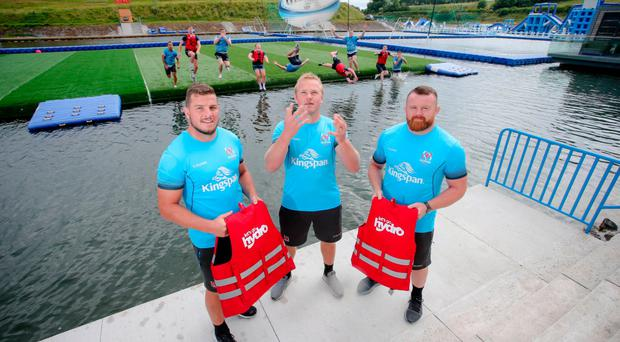 Ulster Rugby players Sean Reidy, Luke Marshall and Andrew Warwick try out the new Aqua Rugby pitch at Lets Go Hydro