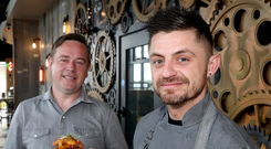 Restaurant owner Darren Clarke (left) and head chef James Lynas celebrate the opening of Moes Grill at The Boulevard