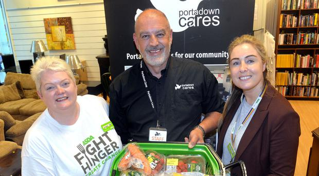 From left, Elaine Livingstone of Asda, Portadown Cares chairman David Taylor and Asda's Kate Hamilton