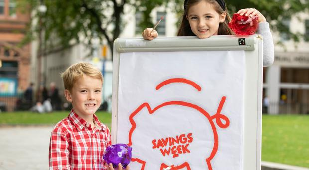 Progressive Building Society today launched its second annual Northern Ireland Savings Week, an initiative which aims to raise awareness across Northern Ireland of the benefits and importance of saving on a regular basis. A key element of the initiative is the NI Savings Week schools competition were pupils will be given the opportunity to redesign the Savings Week logo and share their savings goals. Pictured are Garret Finnegan and Anna Murphy at the launch of Northern Ireland Savings Week.
