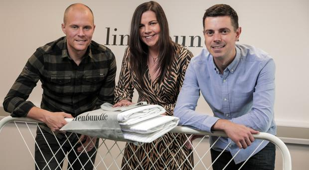 Paul Nesbitt (left) and Thomas Glackin (right), directors at Linen Bundle with Jenna Mairs, senior investment manager at Whiterock Finance