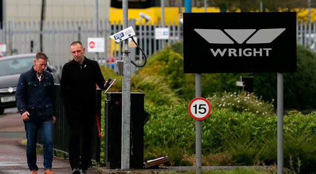 Unite union officials George Brash (right) and Colin Graham leave Wrightbus plant yesterday