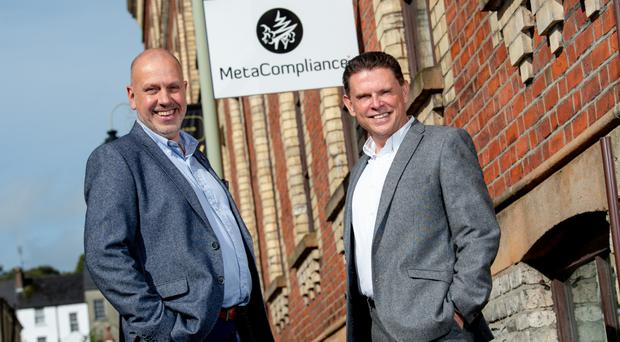 John Hood, multi sector director, Invest NI with Robert O'Brien, chief executive, MetaCompliance, the technology firm that's creating 70 new jobs