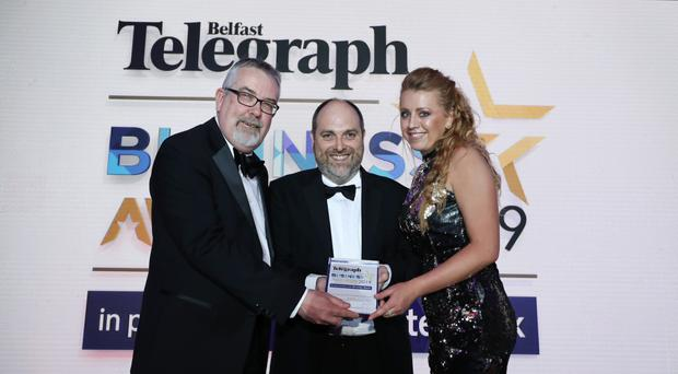 Cherith Morris and Mervyn Russell from Fortress Diagnostics accepting the SME Healthcare Business of the Year award at the Belfast Telegraph Business Awards