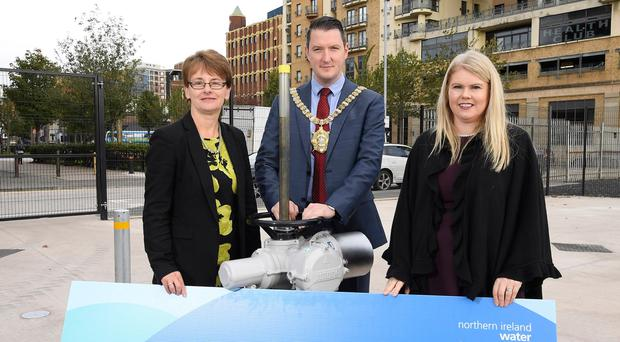 From left, DFI deputy permanent secretary Julie Thompson, Belfast Lord Mayor John Finucane and NI Water chief executive Sara Venning
