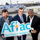 Invest NI's Alastair Hamilton (middle) with Aflac's Keith Farley and Virgil Miller