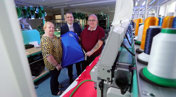 Paul Reid (centre), business development manager at Ulster Bank, at the new C&G Embroidery premises with Carol and Gary Winter