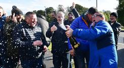 Wrightbus workers celebrate news that a deal had been reached in principle yesterday