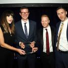 Simon Whittaker of NI Cyber presents Hannah Skinner, Stevie McIntyre and Conor Creeney of Locate A Locum with an award at a recent event