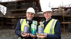 Hinch Distillery managing director Derek Hardy (left) with executive director of business and sector development at Invest NI, Brian Dolaghan