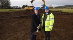 Left: Paul Doyle, relationship manager at AIB (NI) with Bryan Vaughan, managing director of Vaughan Homes