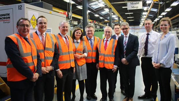 Boeing's Sir Martin Donnelly (fifth right) on visit to Denroy Plastics in Bangor with (from left) Michael Polson, Invest NI; Julian Moore; Mr Holland; Jodie Carson, parliamentary researcher; Stephen Farry MP; and Denroy's Gareth Deering, Kevin McNamee, John Irwin and Kim McCauley