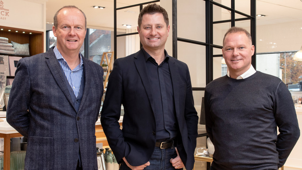 George Clarke of Channel 4's Amazing Spaces (centre) with Gary and Andrew Irwin at Bedeck's revamped Lisburn Road store in Belfast