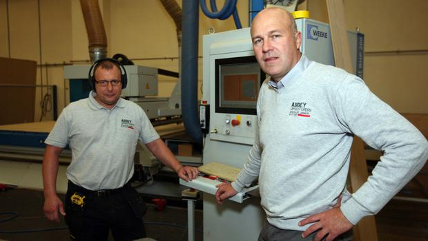 Paul at his company's Meadowbank Road headquarters on the factory floor with Pawel Siwinski