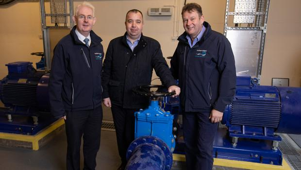 Councillor Brian Tierney (centre) with NI Water's Paul Davison and Gary McFadden
