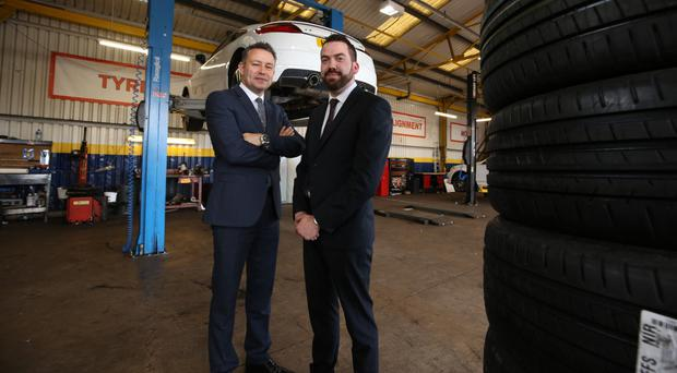 Andrew Gilmore (left), aftersales operations director, with James Thompson, manager of the Sydenham Fast Fit branch of Charles Hurst