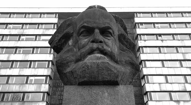 A statue of economic prophet, Karl Marx, whose ideas are both still valid and open to criticism