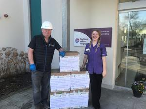 Brian Davison of Portview Fit-Out with a member of staff from the NI Hospice. Portview donated masks to the hospice to help it deal with a shortage