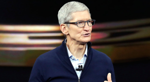 Apple CEO Tim Cook shows the new Apple Watch Series 3 product at the Steve Jobs Theatre