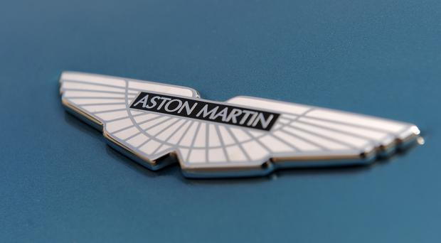 Aston Martin will use £121m to develop its SUV, but the interest rate for the money is 12% (PA)