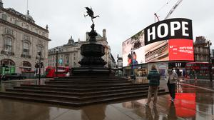 Landsec, owner of the Piccadilly Circus lights, has revealed a slump in sales (Yui Mok/PA)