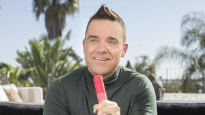 Robbie Williams, one of the celebrity backers of ROXi Music trying out its entertainment console (ROXi)