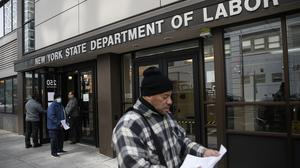 Applications for jobless benefits are surging in some US states as coronavirus concerns shake the economy (John Minchillo/AP)
