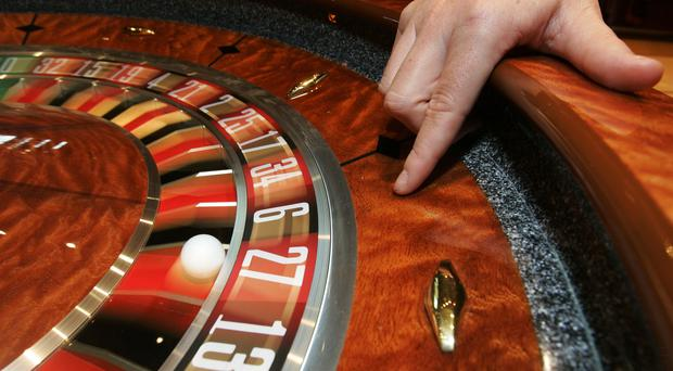 Gambling companies have been under pressure to clamp down on problem betting (Andrew Milligan/PA)
