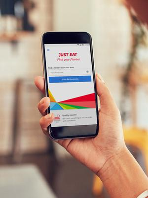 Just Eat shares dipped after the competition watchdog confirmed plans to investigate its takeover by Takeaway.com (Just Eat/PA)