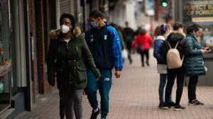 Shoppers wearing protective face masks in Dudley. Twelve million UK adults had a low financial resilience in July the Financial Conduct Authority said (Jacob King/PA)
