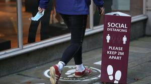 Analysis suggests consumer spending will have shrunk by £6,600 per household on average (Andrew Matthews/PA)