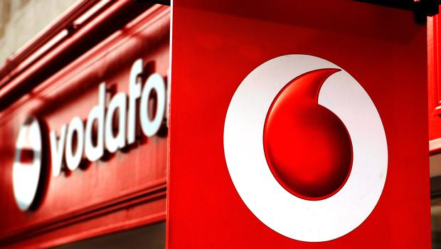 Blue chip giant Vodafone has dialled up big share gains after hiking its earnings outlook as the wider FTSE 100 Index lifted on optimism over the US-China trade war (PA)