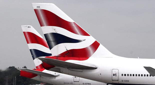 A strike by British Airways pilots has led to bosses issuing a shock profit warning (PA)