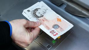 Transactions at cash machines dropped last month (PA)