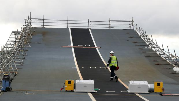 A workman on the under-construction aircraft carrier HMS Prince of Wales at Babcock Rosyth, Fife (Andrew Milligan/PA)