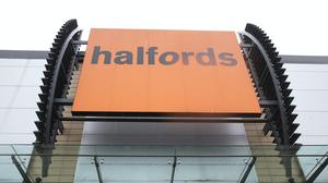 Halfords is expected to be boosted by high demand for bikes (Yui Mok/PA)