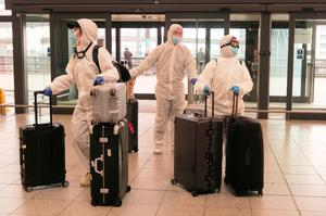 Passengers determined to avoid the coronavirus before leaving the UK arrive at an eerily quiet Gatwick Airport yesterday