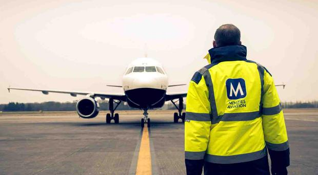 Airport services and support firm John Menzies has been taken to task by shareholders after they voted down plans to cancel preference shares and nearly a fifth rebelled against pay proposals (PA)