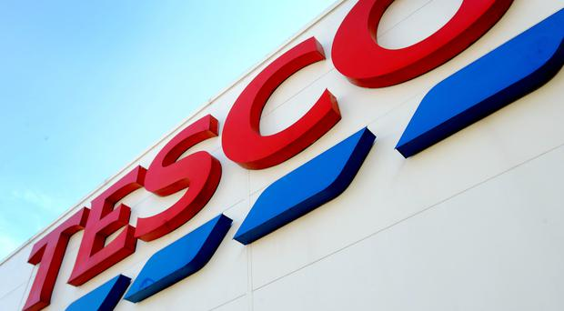 Tesco is unveiling its half year results on Wednesday (PA)