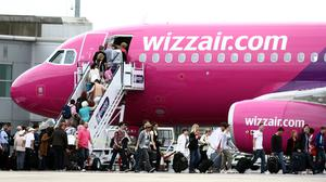 Wizz Air has revealed moves to slash routes, cut costs and freeze recruitment as part of plans to offset plunging demand amid the coronavirus outbreak (Steve Parsons/PA)