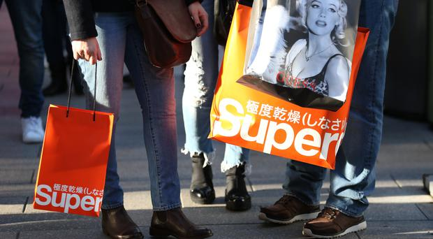 Superdry founder Julian Dunkerton has pledged to stay on as CEO until April 2021 (Steven Paston/PA)