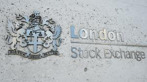 The FTSE 100 Index improved on the back of strong showings by commodity stocks (Kirsty O'Connor/PA)