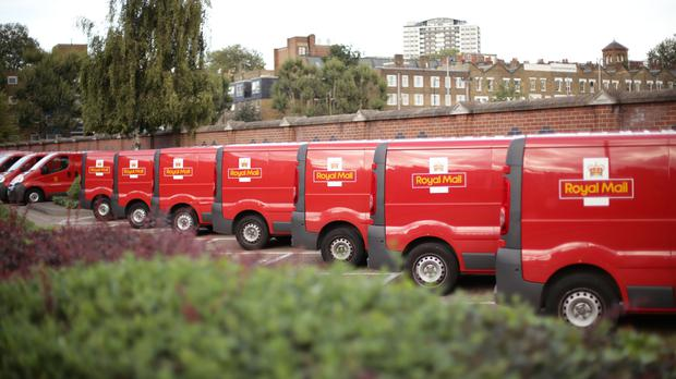 Royal Mail saw letter volumes drop by seven per cent (PA)