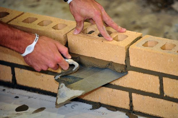 A trainee bricklayer at work (Ian Nicholson/PA)